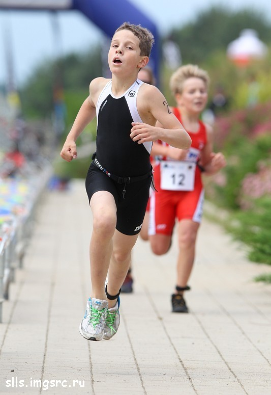 boy in black lycra shorts running during a competition