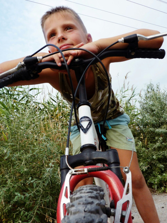 young boy on his mountain bike with nice shorts